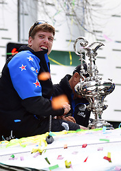 "Helmsman Peter Burling with the Americas Cup as the Emirates Team New Zealand welcome home parade heads downtown, Auckland, New Zealand, Thursday, July 06, 2017. Credit: SNPA / Marty Melville  ""NO ARCHIVING"""