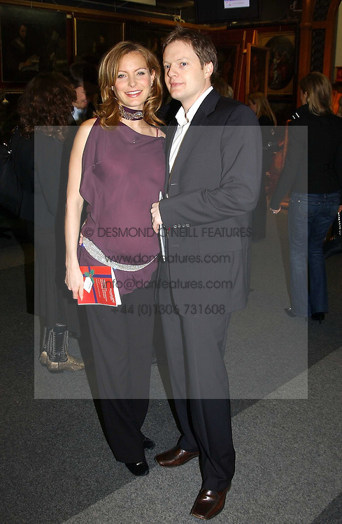 Actress TRACY SHAW and boyfriend ASHLEY POUNDALL at the Macmillan Cancer Relief Celebrity Christmas Stocking Auction held at Christie's, South Kensington, London on 8th December 2004.<br />