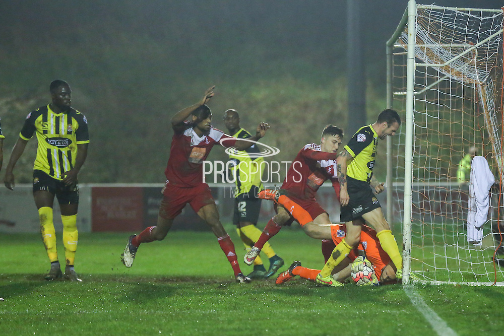 Whitehawk striker Jake Robinson goes close and Dagenham goalkeeper Liam O'Brien collects during the The FA Cup 2nd Round Replay match between Whitehawk FC and Dagenham and Redbridge at the Enclosed Ground, Whitehawk, United Kingdom on 16 December 2015. Photo by Phil Duncan.