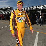 NASCAR Sprint Cup driver Kyle Busch walks in the garage area, during a NASCAR Daytona 500 practice session at Daytona International Speedway on Wednesday, February 20, 2013 in Daytona Beach, Florida.  (AP Photo/Alex Menendez)