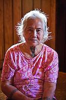 Old Iban woman with tattoos in Nanga Sumpa Longhouse.