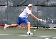 Reid Rossberger, 16, of Cedar Rapids stretches out to reach a ball during a Boys' 16 Singles match at the 2011 Baird Iowa Open tennis tournament at Veterans Memorial Tennis Center in Cedar Rapids on Wednesday, July 27, 2011. Over 200 players from Colorado, Illinois, Iowa, and South Dakota, participated in the event.