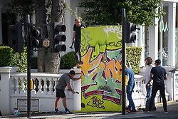 © Licensed to London News Pictures. 23/08/2019. London, UK. Graffiti covered boards being erected around the Paul Smith store as preparations begin in Notting Hill, West London ahead of the 2018 Notting Hill Carnival which starts this weekend. Warm weather is expected over the bank holiday weekend with carnival attracting over 1 million people to the capital. Photo credit: Ben Cawthra/LNP