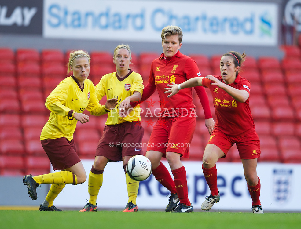 LIVERPOOL, ENGLAND - Friday, April 26, 2013: Liverpool's Katrin Omarsdottir and Amanda Da Costa in action against Arsenal during the FA Women's Cup Semi-Final match at Anfield. (Pic by David Rawcliffe/Propaganda)