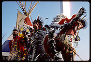 Indian dancers perform in front of teepees and Arch during a folk festival in St. Louis. Missouri