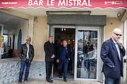 Vote de Gilbert Collard au second tour des élections municipales 2014 , candidat front national RBM dans la ville de St Gilles , dans les rues de St Gilles après son vote