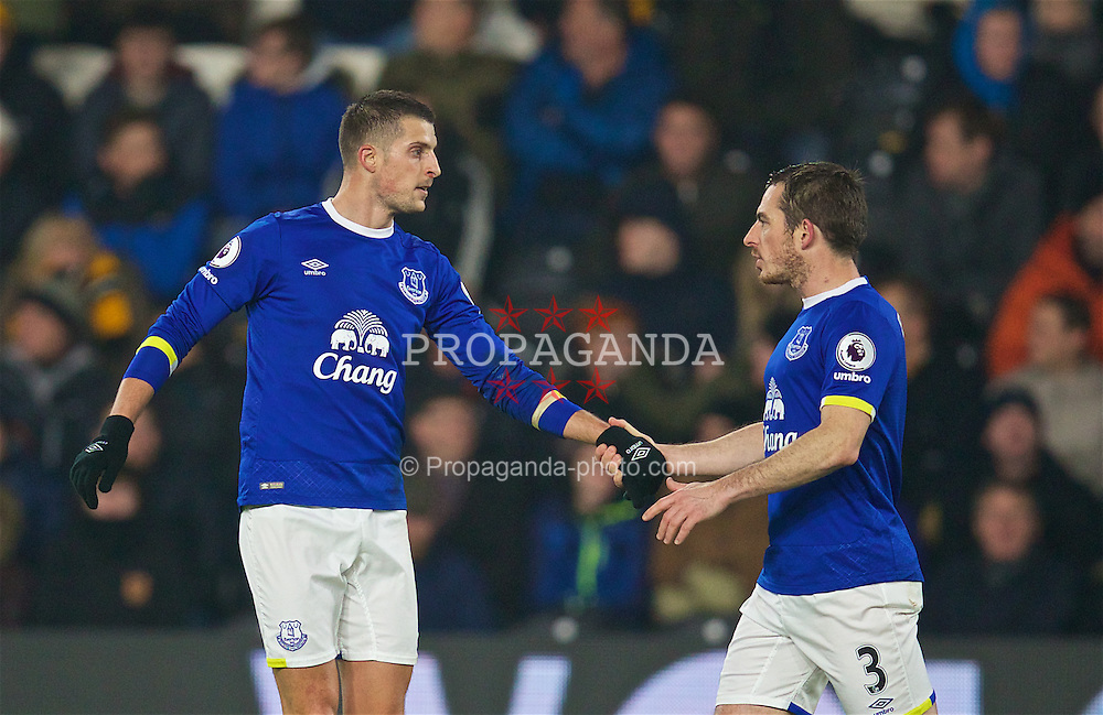 KINGSTON-UPON-HULL, ENGLAND - Friday, December 30, 2016: Everton's Kevin Mirallas celebrates with team-mate Leighton Baines after his corner forced a Hull City own-goal during the FA Premier League match at the KCOM Stadium. (Pic by David Rawcliffe/Propaganda)