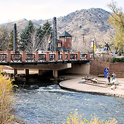 A bridge spans Clear Creek in Golden, Colorado, just outside Denver at the eastern edge of the Rocky Mountains.
