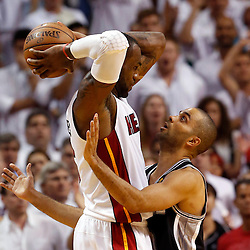 Jun 18, 2013; Miami, FL, USA; San Antonio Spurs point guard Tony Parker (9) defends Miami Heat small forward LeBron James (6) during the fourth quarter of game six in the 2013 NBA Finals at American Airlines Arena.  Mandatory Credit: Derick E. Hingle-USA TODAY Sports