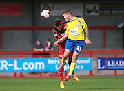 Accrington Stanley striker Billy Kee wins a header against Sonny Bradley during the Sky Bet League 2 match between Crawley Town and Accrington Stanley at the Checkatrade.com Stadium, Crawley, England on 26 September 2015. Photo by Bennett Dean.