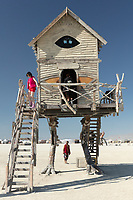 Baba Yaga's House by: Jessi Sprocket Janusee and Baba Yaga's Book Club from: Reno, NV year: 2018<br /> <br /> The house of Baba Yaga will rise from the playa straddling it's mechanical chicken legs. The crone's house will be poised to run at the slightest provocation. Ascend her staircases to test the old witch if you dare. Are you able to walk through the veil of mortality into the space where the seer dwells? If you are strong of will, feeling bold and willing to show vulnerability she may allow you to venture within her sanctum.<br /> <br /> URL: http://jessisprocket.com/baba-yaga/ My Burning Man 2018 Photos:<br />