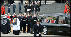 Lady Thatcher coffin is placed in the hearse watched by her family after her funeral at St Paul's Cathedral following her death last week, London, UK, Wednesday 17 April, 2013, Photo by: Andrew Parsons / i-Images