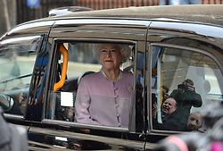 A waxwork of Queen Elizabeth II is driven past the Lindo Wing at St Mary's Hospital in Paddington, London in a taxi, where the real monarch's sixth great-grandchild and a younger sibling of Prince George and Princess Charlotte was born on Monday.