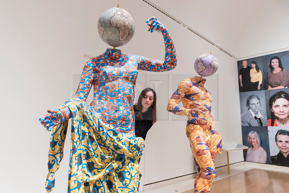 "© Licensed to London News Pictures. 07/12/2017. London, UK.  A staff member views (L to R) ""Discobolus (After Naukydes)"", 2017, and ""The Townley Venus"", 2017, both by Yinka Shonibare, RA, at a preview of ""From Life"", a special exhibition at the Royal Academy examining what making art from life has meant to artists throughout history and how the practice has evolved as technology opens up new ways of creating artworks.  The exhibition runs 11 December to 11 March 2018.  Photo credit: Stephen Chung/LNP"