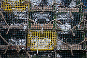 April 27, 2011 - Lobster traps stacked on a dock in Sandwich, MA.