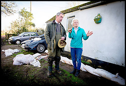 UKIP Leader Nigel Farage talks to a member of the community as the flood water rises in her back garden in Burrowbridge, Somerset, United Kingdom. Sunday, 9th February 2014. Somerset has been flooded since the start of 2014, with people being forced to leave their homes. Picture by Andrew Parsons / i-Images
