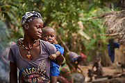 Sai Kamara, 20 years old and her son Abduli in the village of Kaingba, Tonkolili district, Sierra Leone on March 24, 2017. Mohamed Koroma, a 40-year-old Community health worker in her village helped save the life of Sai Kamara when she experienced post-partum hemorrhage after she tried to deliver her second child at home. Sai unfortunately lost the baby but she survived because Mohamed used his own money and rushed with her to the nearest health facility. Mohamed also ensured that the people involved in the delivery were fined about USD 7 to discourage other people from even thinking about performing home deliveries. Mohamed is one of 1,342 CHWs supported by the Government of Japan, through UNICEF, to provide basic essential health services to pregnant women, lactating mothers and children under five in the district.<br /> <br /> &ldquo;I lost my baby and almost lost my life when I was delivered at home. Giving birth at home is really bad. Now I won&rsquo;t need to be reminded at all, to go to the health facility when I am ready to have my next child.&rdquo; Sai Kamara, 20.