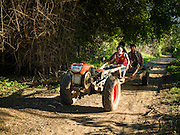 18 JUNE 2016 - DON KHONE, CHAMPASAK, LAOS: A tractor pressed into service as mass transit on Don Khone. Don Khone Island, one of the larger islands in the 4,000 Islands chain on the Mekong River in southern Laos. The island has become a backpacker hot spot, there are lots of guest houses and small restaurants on the north end of the island.     PHOTO BY JACK KURTZ