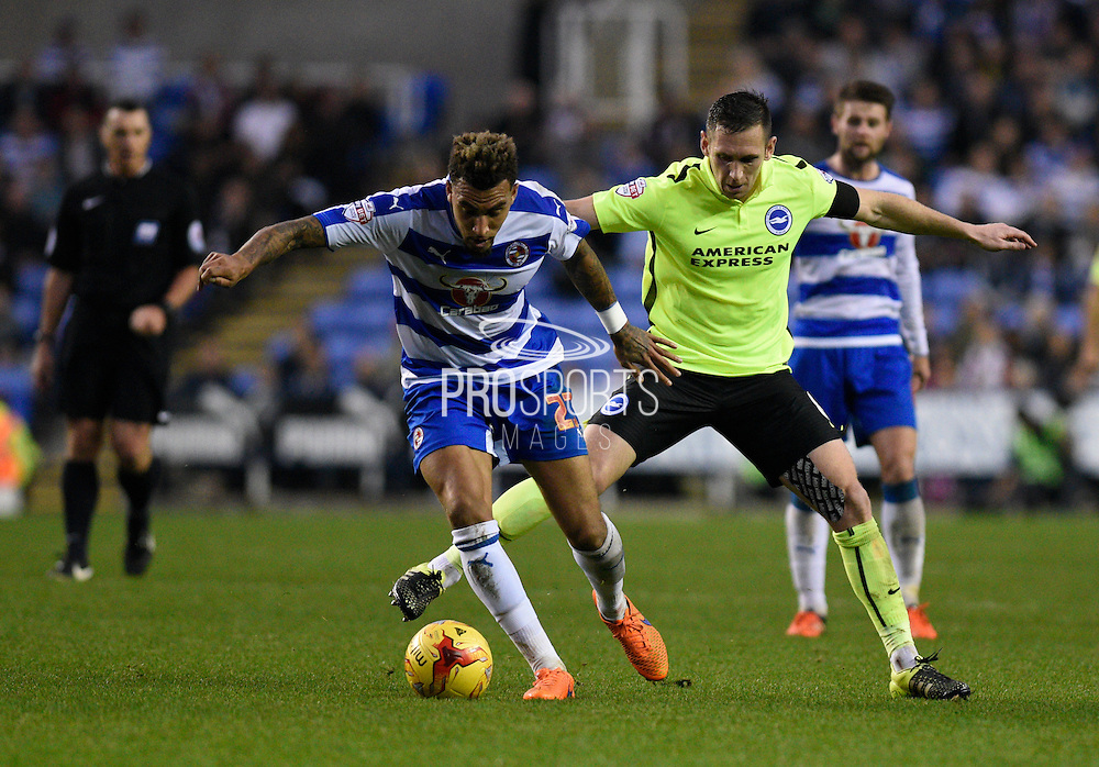 Reading midfielder Daniel Williams (23) battles for the ball with Brighton central midfielder, Andrew Crofts (8) during the Sky Bet Championship match between Reading and Brighton and Hove Albion at the Madejski Stadium, Reading, England on 31 October 2015. Photo by David Charbit.