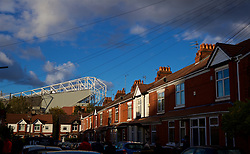 MANCHESTER, ENGLAND - Sunday, October 28, 2018: Old Trafford's main stand looms large over local terraced housing before the FA Premier League match between Manchester United FC and Everton FC at Old Trafford. (Pic by David Rawcliffe/Propaganda)