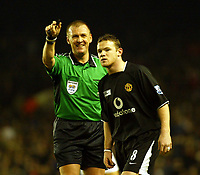 Fotball<br /> England 2004/2005<br /> Foto: SBI/Digitalsport<br /> NORWAY ONLY<br /> <br /> Arsenal v Manchester United<br /> Barclays Premiership. 01/02/2005<br /> Wayne Rooney can't see the funny side as Graham Poll laughs away in the first half.