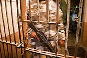"05 FEBRUARY 2005 - NOGALES, SONORA, MEXICO: A Nogales, Mexico, police officer stands in the doorway of the jail in Nogales. Members of ""Grupo Operativos"" a special operations unit of the Nogales, Sonora, Mexico, police department, on patrol in Nogales, Saturday night, Feb. 5. The Operativos specialize in anti-gang enforcement and drug interdiction missions. In recent months they have stepped up patrol activity in Nogales communities near the border. In January 2005, the US Department of State has issued a travel advisory advising US citizens to avoid travel along the US Mexican border because of increased violence, including the kidnapping of US citizens, in border communities. Most of the violence has been linked to the drug cartels, who are increasingly powerful in Mexico. The Operativos also patrol the districts of Nogales frequented by US tourists in an effort to prevent crime directed against US citizens.   PHOTO BY JACK KURTZ"