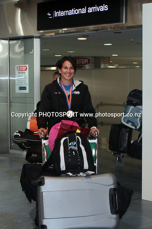 Kayla Sharland. Black Sticks Women's arrive at Auckland Airport after winning Bronze in the Champions Trophy. Auckland, New Zealand. Wednesday 6 July 2011. Photo: Ella Brockelsby/photosport.co.nz