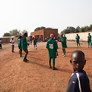 In front of some supporters, Les Amazones of Bacodjikoronì (Bamako) are warming with the soccer ball before second match of a national league.