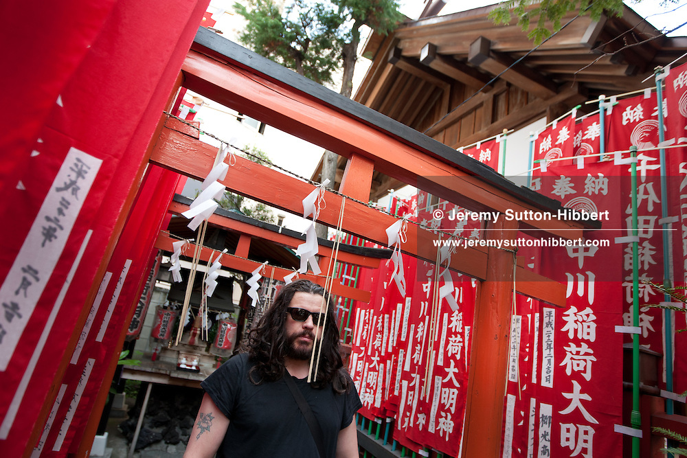 Ian Astbury, lead singer with The Cult, at a shrine in the Shibuya district of Tokyo, Japan, Sunday 28th November 2010. Ian Astbury was in Tokyo to play as part of the band 'BXI'- a musical collaboration between himself and Japanese band 'Boris'. 'BXI' played at Club WWW, in Shibuya, Tokyo.