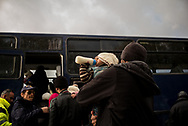 After the landed on the coast of Lesvos crossing the sea between Turkey and Greece a group of migrants is seen boarding on a bus headed to the Moria camp where they will be registred. About 8500 migrants and refugees are living in hard condition on the island of Lesvos, many of them outside the organized camp. Mitilene, Greece. December 12th 2017.