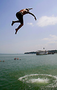 funny kid jumping from pier into water