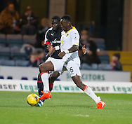 Partick Thistle&rsquo;s Adebayo Azeez and Dundee&rsquo;s Kevin Gomis - Dundee v Partick Thistle in the Ladbrokes Scottish Premiership at Dens Park, Dundee. Photo: David Young<br /> <br />  - &copy; David Young - www.davidyoungphoto.co.uk - email: davidyoungphoto@gmail.com