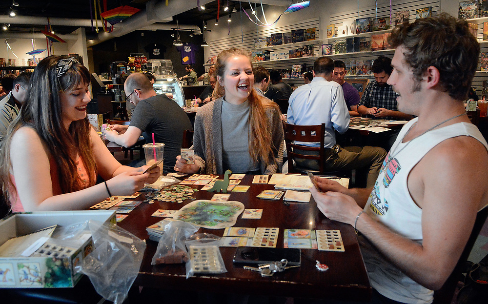 """jt050317k/spec sec/jim thompson/  left to right- Stephanie Dailey, Diane-Lori Wieck and Rhett Butler play the game """"Evolution"""" at the Empire Board Game Library Wednesday night. Wednesday May. 03, 2017. (Jim Thompson/Albuquerque Journal)"""