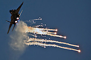 Israeli Air force F-15I Fighter in flight Emitting anti-missile flares