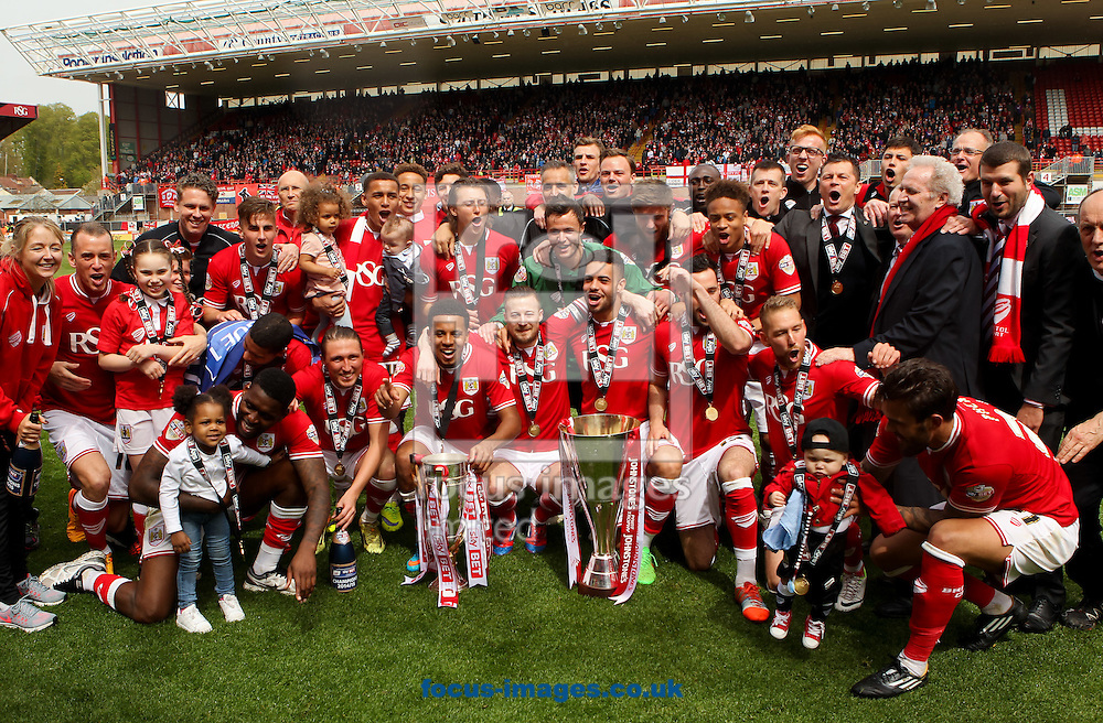 Bristol City celebrate with the Sky Bet League 1 Trophy and Johnstones Paint Trophy after the Sky Bet League 1 match at Ashton Gate, Bristol<br /> Picture by Tom Smith/Focus Images Ltd 07545141164<br /> 03/05/2015