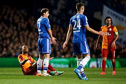 Galatasaray Forward Didier Drogba (CIV) looks up at Chelsea Defender Branislav Ivanovic (SRB) after being fouled - Photo mandatory by-line: Rogan Thomson/JMP - 18/03/2014 - SPORT - FOOTBALL - Stamford Bridge, London - Chelsea v Galatasaray - UEFA Champions League Round of 16 Second leg.