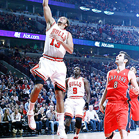 24 March 2012: Chicago Bulls center Joakim Noah (13) goes for the dunk past Toronto Raptors point guard Jose Calderon (8) during the Chicago Bulls 102-101 victory in overtime over the Toronto Raptors at the United Center, Chicago, Illinois, USA.