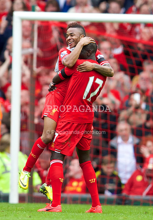 LIVERPOOL, ENGLAND - Sunday, April 13, 2014: Liverpool Raheem Sterling and Mamadou Sakho celebrate their side's 3-2 victory over Manchester City during the Premiership match at Anfield. (Pic by David Rawcliffe/Propaganda)