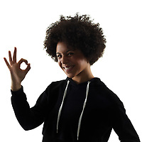 one mixed race african young teenager girl woman in studio shadow silhouette isolated on white background