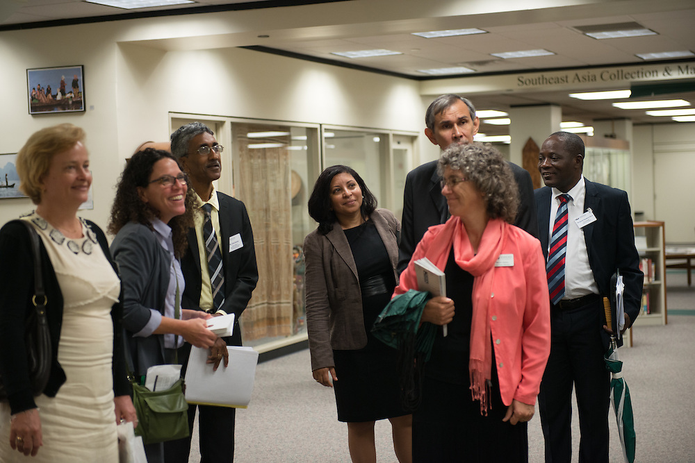 A delegation from the University of Guyana tours the Center for International Collections at Alden Library. Photo by Ben Siegel