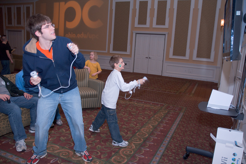 Kyle Moore (L) and Ryan Gwin (R) box on a Wii during UPC SibsFest at the Baker Center