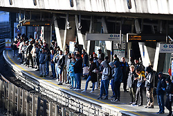 © Licensed to London News Pictures. 13/05/2020.  London UK:  Commuters at Canning Town station in Newham, east London, crowd the platform as the government relaxed some rules allowing people to travel to work if they are unable to work from home , Photo credit: Steve Poston/LNP
