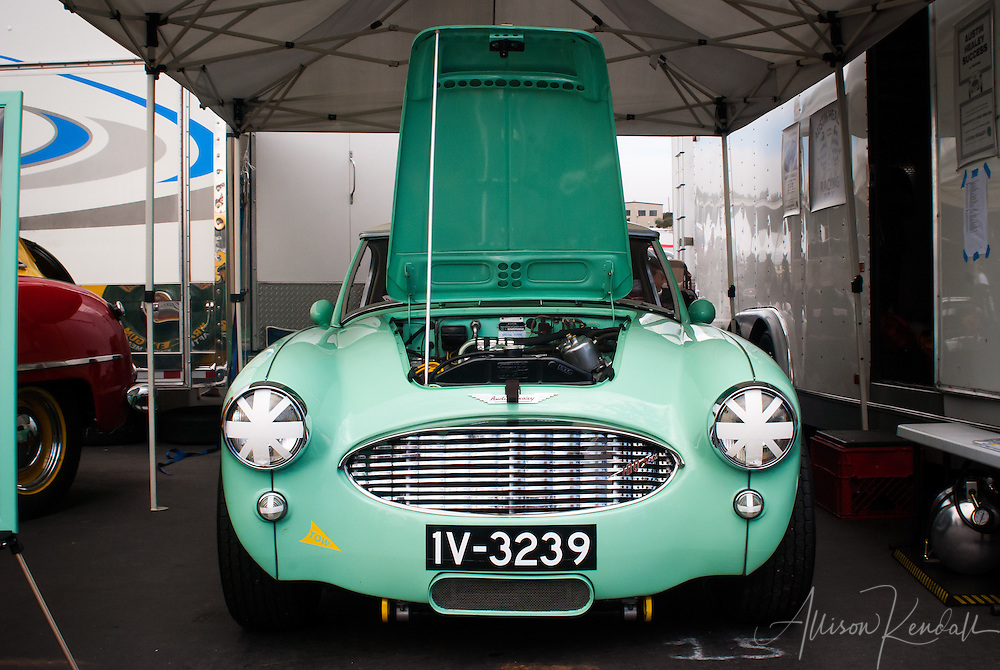 A 1957 Austin Healey 100-SIX MM driven by Doug Escriva at the Rolex Monterey Motorsports Reunion during Monterey Car Week