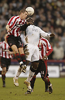 Photo: Aidan Ellis.<br /> Sheffield United v Swansea City. The FA Cup. 06/01/2007.<br /> Swansea's Adebayo Akinfenwa loses out the header to Sheffield's Chris Armstrong