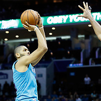 01 November 2015: Charlotte Hornets forward Nicolas Batum (5) takes a jump shot during the Atlanta Hawks 94-92 victory over the Charlotte Hornets, at the Time Warner Cable Arena, in Charlotte, North Carolina, USA.