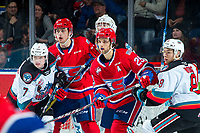 KELOWNA, BC - JANUARY 31: Conner McDonald #7 and Trevor Wong #8 of the Kelowna Rockets check Leif Mattson #28 and Eli Zummack #29 of the Spokane Chiefs during third period at Prospera Place on January 31, 2020 in Kelowna, Canada. (Photo by Marissa Baecker/Shoot the Breeze)