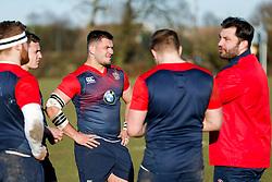 England U20 prop Lewis Boyce looks on as Former England International prop Alex Corbisiero (R) takes training in his new role as England U20 positional coach - Mandatory byline: Rogan Thomson/JMP - 08/03/2016 - RUGBY UNION - Clifton Rugby Club - Bristol, England - England Under 20s Training at Bristol Rugby.