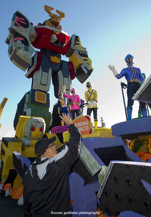Power Rangers practice their choreography on the NAMCO BANDAI Games America, Inc. Rose Parade float, in Azusa, Calif. The float, featuring Saban's Power Rangers Samurai, will roll down Colorado Blvd. in the parade, Monday, Jan. 2. NAMCO Photo/BANDAI Games America, Inc., Susan Goldman.