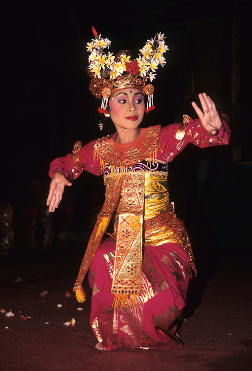 Asia, Indonesia, Bali, Ubud. Traditional dancer uses expressive hand motions in the Legong Dance at Ubud Palace.