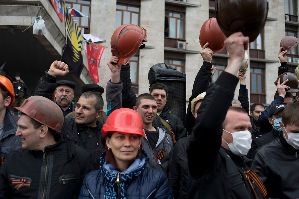 Coal miners show support for separatists occupying the Donbass regional government building in Donetsk.